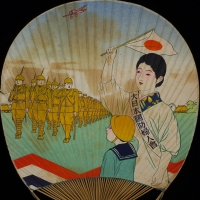 3129. Fan depicting a member of the Japan National Defense Women's Association (大日本国防婦人會)