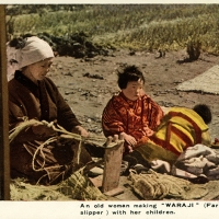 2336. An old woman making WARAJI (Farmer's slipper) with her children