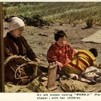 2336. An old woman making WARAJI (Farmer's slipper) with her children