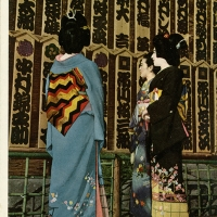 2337. Geisha Girls looking up the actor-list of KABUKI that is the generic term for classical dance of Japan