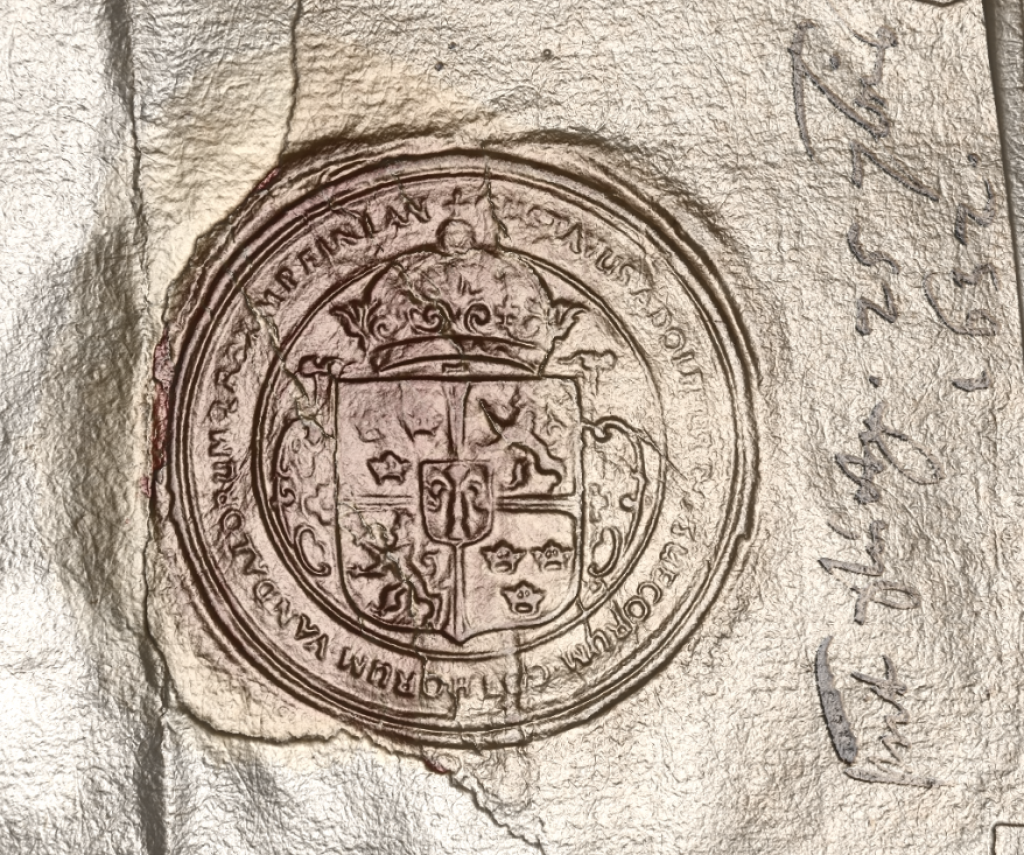 This version of the seal done using RTI and shown in relief, exposes further detail and renders the text more clearly.