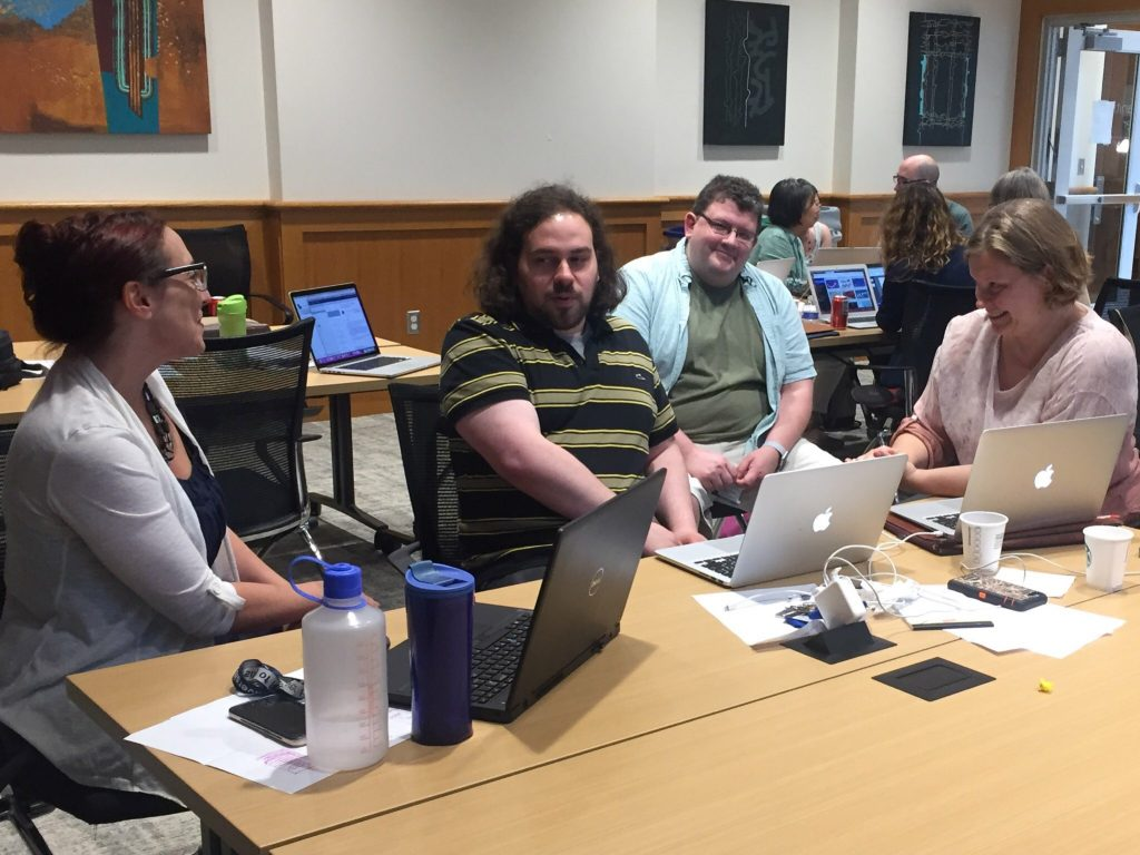 Faculty works with library staff to discuss possibilities for a new assignment using digital tools.