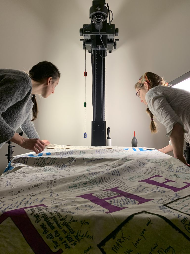Picture of DSL lab staff imaging the AIDS quilt with the Phase One Camera